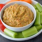 This Spicy Roasted Red Pepper Hummus is made without tahini and is an easy healthy snack!