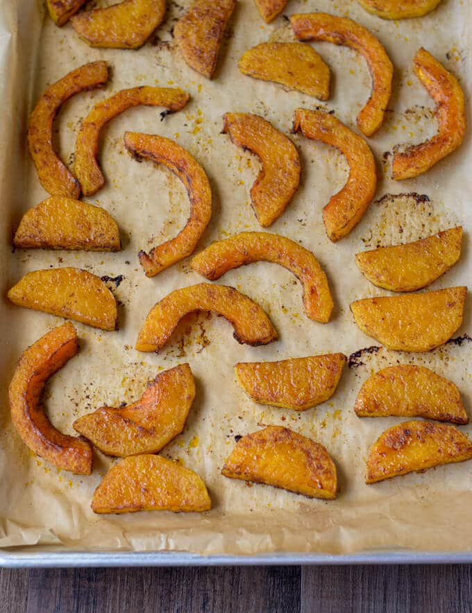 A sheet pan with slices of butternut squash.